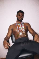 African athlete with medals on his chest