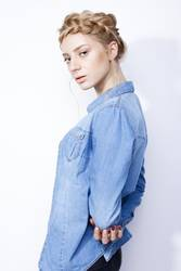 stylish girl in denim jacket and creative hairstyle