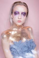 girl in sequins and with creative makeup