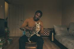 African student stroking a cat