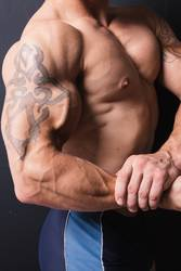 muscular bodybuilder with a tattoo on his arm