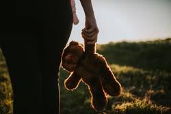 Mother holding Teddy bear