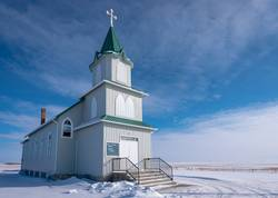 Snow surrounds a historic Lutheran church in Canada