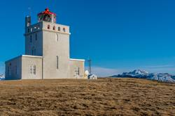 The Dyrholaey Lighthouse towers over landscape in Iceland