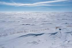 Vast snow covered field in Saskatchewan, Canada
