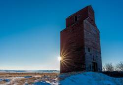 Sunburst at a historic grain elevator in Saskatchewan, Canada