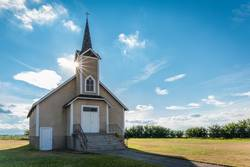 Sunburst over a historic Lutheran church in Canada