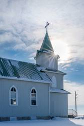 Sunburst over historic Lutheran church in Canada