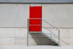 red door on the white wall