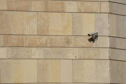 security camera on the wall of the building