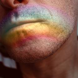 face with a rainbow on the lips
