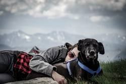 Cuddling with Dog on Mountains Peak