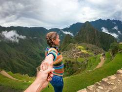 couple contemplating the terraces over Machu Picchu