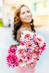 A young woman holding a bouquet of wildflowers in her hands