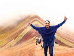 tourist enjoying the view of the incredible Rainbow Mountains