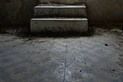 dusty steps and dirty tiled floor