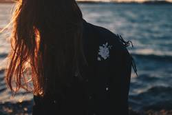 Sunkissed hair. Backlight of hair. Girl at the sea