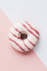 Top view of pink donut on white and pink background