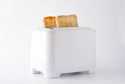 Toasted toast bread in white toaster isolated