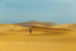 man in desert dunes , china