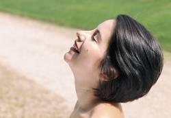 happy woman in park , spain - europe