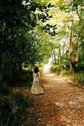 woman walking romantically through an autumn forest