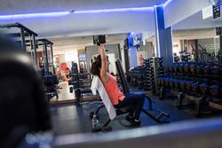 woman training in gym with weights