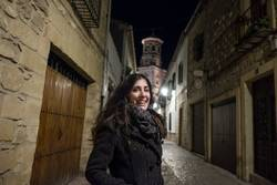 wide angle iage of woman in european old streets