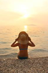 Young woman enjoy the sea sunset