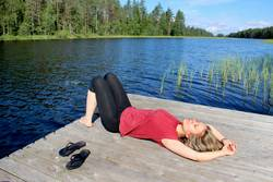 Young beautiful woman enjoy the nature of Finland, Karelia