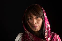 Portrait of Korean woman with scarf.