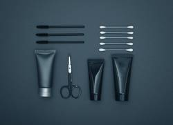 Flatlay of masculine personal care products in black