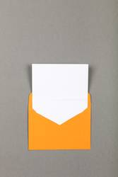 Open yellow paper envelope over grey