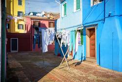 Hung laundry on the lines in front of houses in Burano.