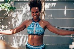 Young Melanesian woman doing exercise