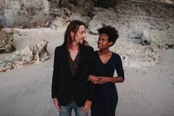 Mixed race couple on the beach, honeymoon