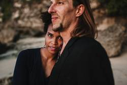 Mixed race couple in love on the beach
