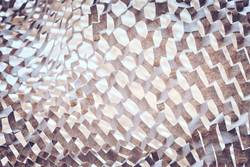 Abstract background made of perforated brown paper.