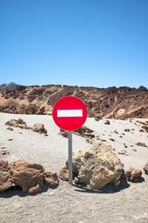 Mars like landscape with No Entry traffic sign.