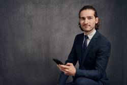 Young man in suit with smartphone