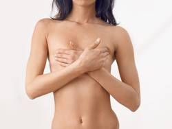 Torso of a slender middle-aged naked woman