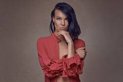 Sexy woman with unbuttoned red shirt