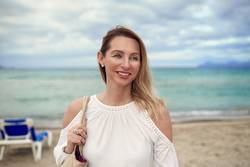 Attractive trendy woman on a tropical resort beach