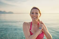 Happy smiling middle-aged woman at the seaside