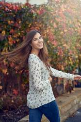 Carefree happy young woman tossing her hair