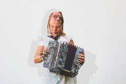 Double Exposure picture of a young woman playing the accordion