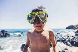 Active Young boys in a funny beach day in the summer time