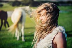 a blonde woman in a windy day
