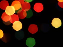 Blurred abstract lights flashing on a black background.