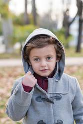 Child posing with warm clothes.